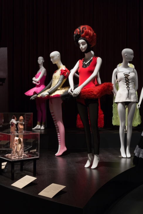 Installation view of Dance & Fashion, featuring ballet costumes designed by (L to R), Isaac Mizrahi, Christian Lacroix, Jean Paul Gaultier and Yves Saint Laurent. Photograph © The Museum at FIT, New York.